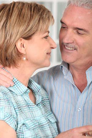 permanence: Senior couple embracing Stock Photo