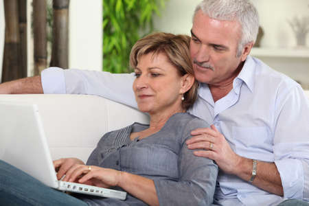 Mature couple browsing on the Internet photo