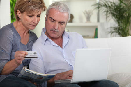 business transaction: Couple purchasing over the  internet