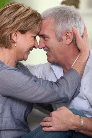 Mature couple embracing Stock Photo - 14215051