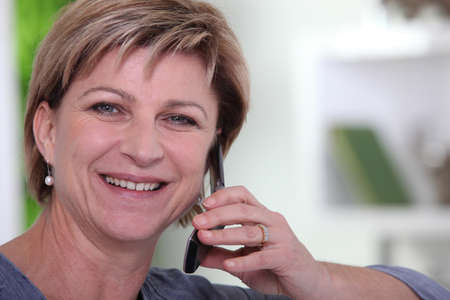 woman phone: senior woman at phone Stock Photo