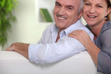 2 50: Middle-aged couple at home Stock Photo