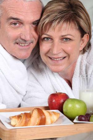 senior couple having breakfast photo