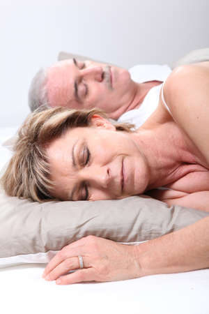 mid adult couples: Mature couple asleep in bed Stock Photo
