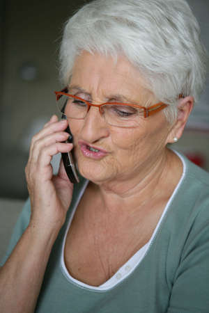 Senior woman on a cellphone Stock Photo - 14203962