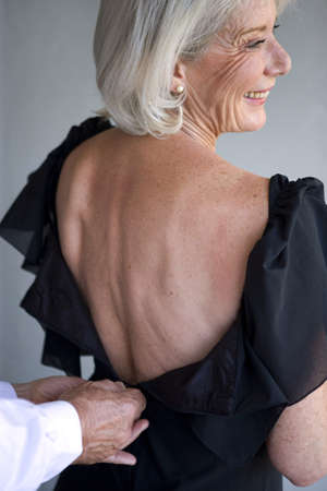 low cut: Woman wearing a dress with a low back