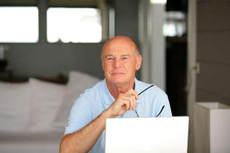 silver surfer: Senior man using a laptop computer at home Stock Photo