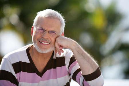 natty: Happy senior man sitting in the sunshine