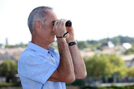 Elderly man with binoculars Stock Photo - 14212091