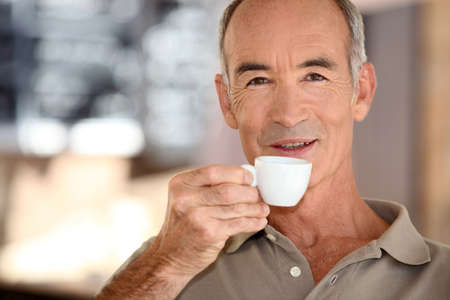 available time: Elderly man drinking coffee Stock Photo