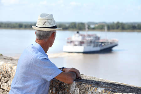 missed: Tourist watching a ferry Stock Photo