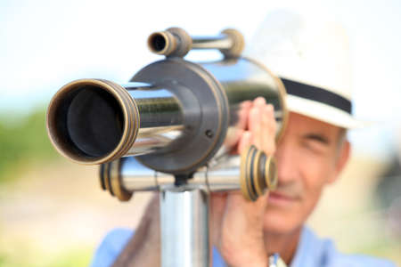 Man with telescope Stock Photo - 14203937