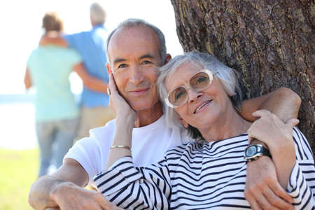 proximity: Senior couple embracing in a field