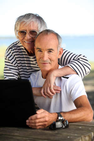 65 years old: Elderly couple with a computer Stock Photo