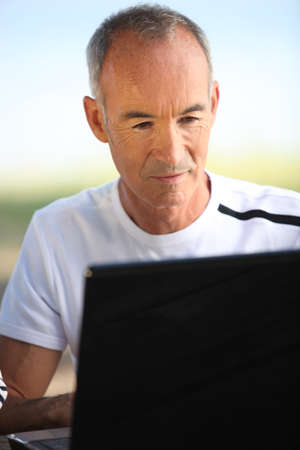 Man with computer Stock Photo - 14203951