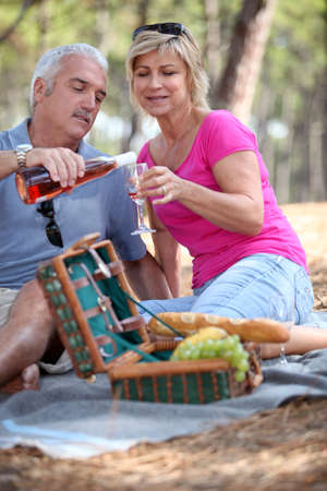 senior couple having a picnic photo