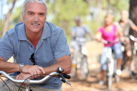 Retiree having a bike ride with friends