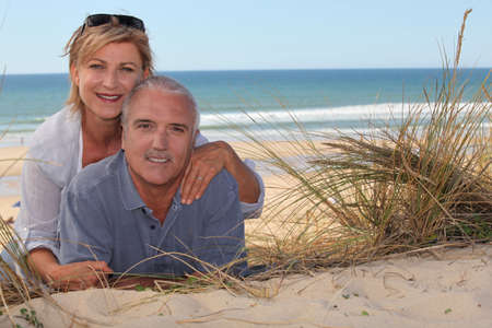 senior couple at the beach photo