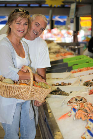 fish shop: Couple at the shop Stock Photo