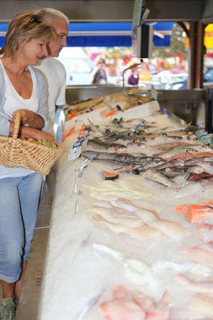 Senior couple in a shop Stock Photo - 14213808