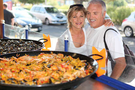 Couple in front of paella photo