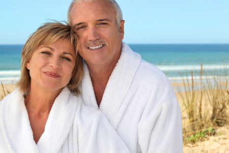 median age: Mature couple in bathrobe