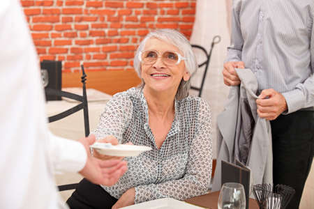 reacts: Couple paying a bill in a restaurant Stock Photo