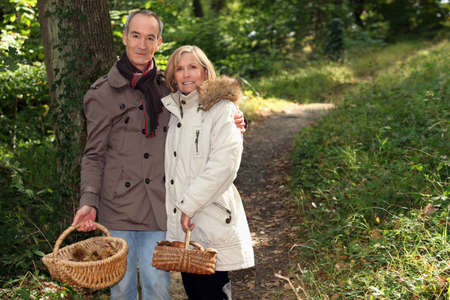 parka: Couple with basket of chestnuts and mushrooms