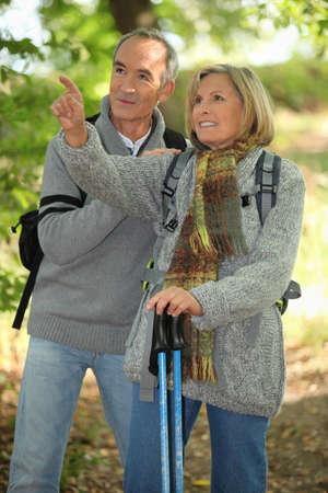 Old people hiking photo