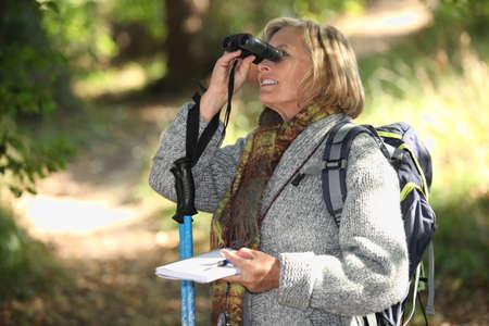 Woman with binoculars Stock Photo - 14214593