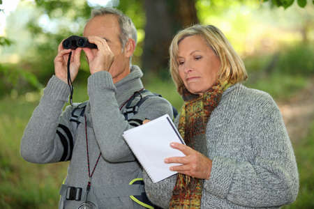 Couple with binoculars Stock Photo - 14203502