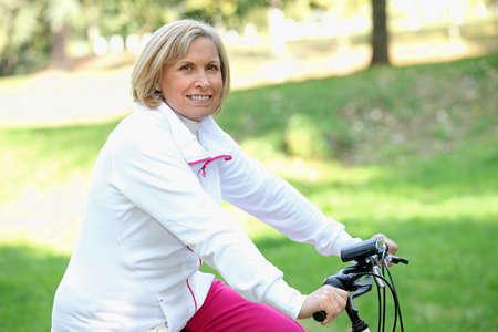 Woman cycling Stock Photo - 14203435