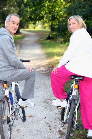 keep fit: Biking for senior people Stock Photo