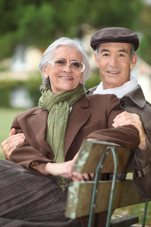A mature couple on a bench. photo