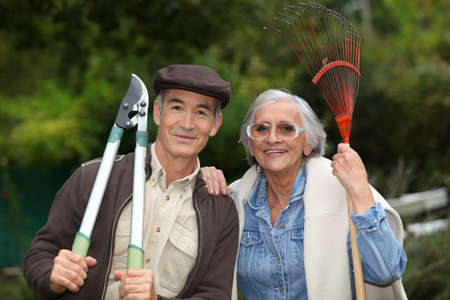 couple of pensioners gardening photo
