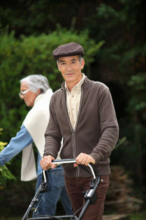 Elderly couple gardening photo