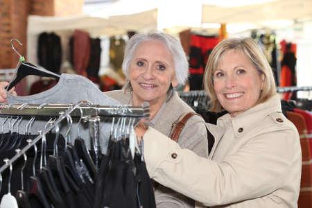 choosing clothes: Women choosing clothes