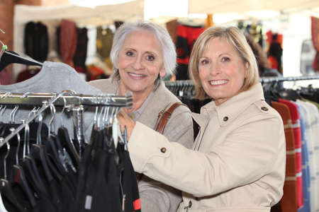 median age: Women in clothing store Stock Photo