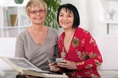 Senior women watching a photo album photo