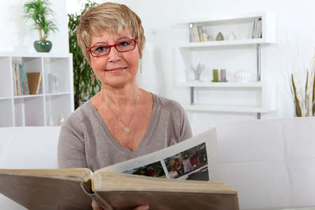Woman looking at a photo album photo