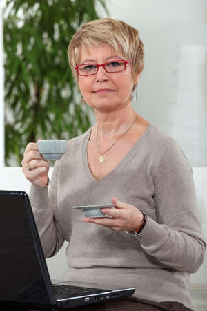 Woman with computer and coffee cup Stock Photo - 14203613