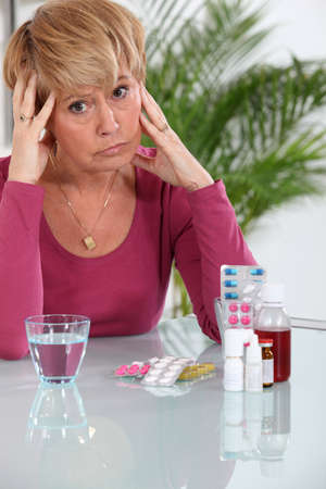 Older woman concerned about her pills Stock Photo - 14203620