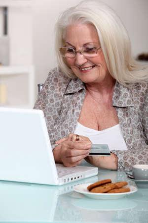 paying: senior lady shopping on the internet Stock Photo