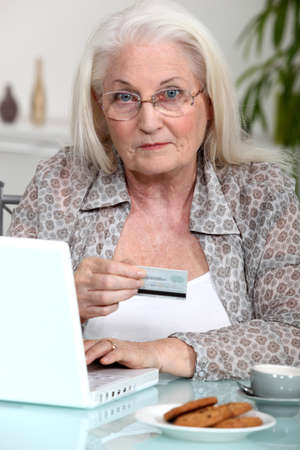 online safety: grandmother shopping online Stock Photo