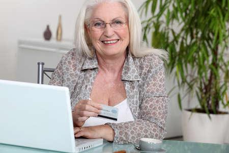 Senior woman paying online photo