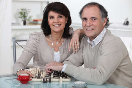 Couple playing chess together Stock Photo - 14203898