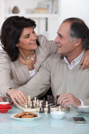Loving couple playing chess together Stock Photo - 14203907
