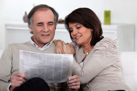 Couple reading the newspaper together photo