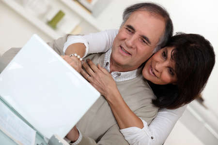 A middle age couple with a laptop. photo