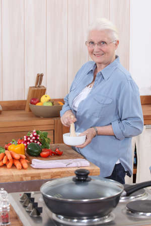 Woman cooking in the kitchen photo
